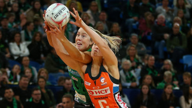 Controvery: Jessica Anstiss of the Fever battles for the ball with the Giants' Jamie-Lee Price.