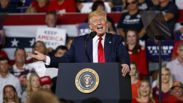 US President Donald Trump speaks at a campaign rally at Williams Arena in Greenville, NC.