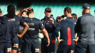 Roosters coach Trent Robinson lays down the law to his players during the week.