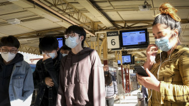 Many public transport users were wearing protective face masks at Flinders Street Station on Sunday.