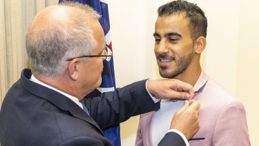 Hakeem Al-Araibi (right) with Prime Minister Scott Morrison at the citizenship ceremony.