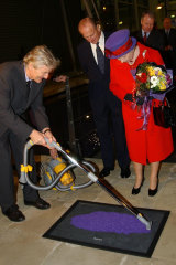 The Queen and the Duke of Edinburgh watch James Dyson unveil a plaque at the vacuum cleaner maker's factory,  2001.