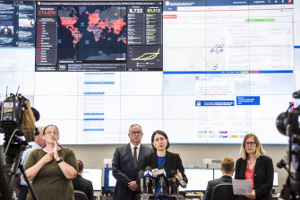 Premier Gladys Berejiklian, Minister for Health Brad Hazzard, NSW Chief Health Officer Dr Kerry Chant at the State Emergency Operations Centre.