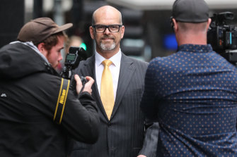 Former police commissioner Simon Overland arrives at the royal commission last year.