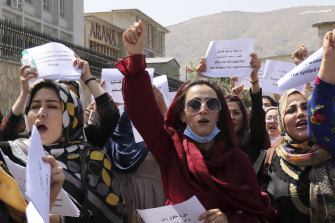 Women gather to demand their rights under the Taliban rule during a protest in Kabul on September 3.
