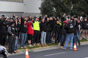 Hundreds of workers protest outside the Hawthorn East building site on July 1 last year.