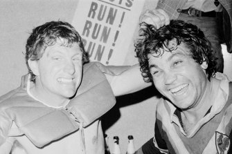 Eastern Suburbs stars Ron Coote (left) and Arthur Beetson share the joys of victory in the dressing room after the 1975 grand final between Easts and St George.