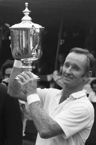 Rod Laver with the US Open trophy in 1969, having won his second Grand Slam - a feat never equalled.