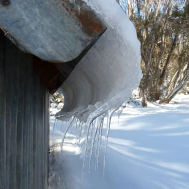 Icicles on the tin roof of Horse Camp Hut.
