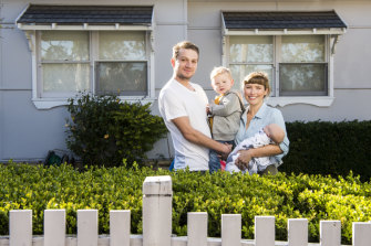 Erin and Andrew Coggins with their son Finn and daughter Luca outside their North Parramatta home.
