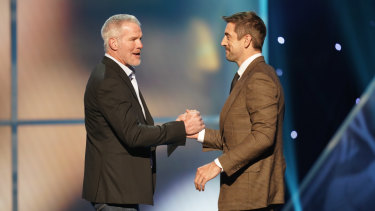 Brett Favre (left) and Rodgers at an NFL awards ceremony earlier this month.