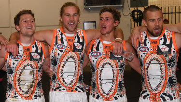 Sing when you're winning: GWS celebrate their Indigenous Round win over the Demons in Melbourne.