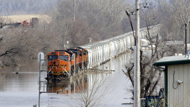 A train sits in flood waters from the Platte River, in Plattsmouth, Nebraska, on Sunday.