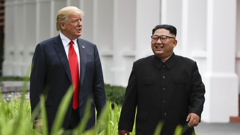 Donald Trump and Kim Jong-un walk together after lunch.