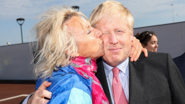 Johnson is kissed by a member of the public during a visit to the Port of Dover recently.