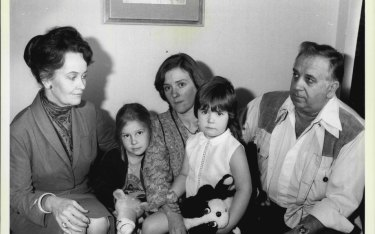 Lorraine Warren (left) with the family who were frightened out of their Gladesville home.