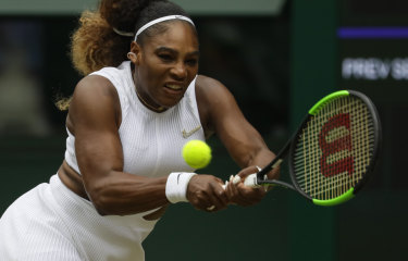 Serena Williams returns the ball to Alison Riske during their Wimbledon quarter-final on Tuesday.
