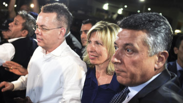 Pastor Andrew Brunson, left, and his wife Norine Brunson arrive at Adnan Menderes airport for a flight to Germany after his release following his trial in Izmir, Turkey.
