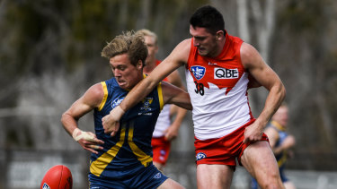 Canberra's Angus Baker and Sydney's Colin O'Riordan fight for the ball.