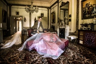 Adam Lindsay, executive director of Sydney Living Museums uncovering furniture which has been protected from dust and sunlight in the drawing room of Vaucluse House.