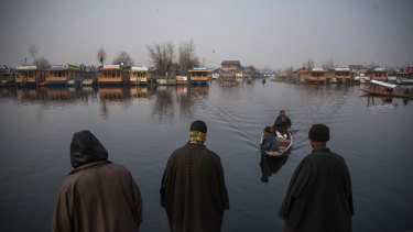 Boat owners at Dal Lake in Kashmir, a once-popular tourist destination in Srinagar.