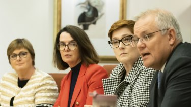 Minister for Government Services and Minister for the NDIS Linda Reynolds, Minister for Families and Social Services and Minister for Women's Safety Anne Ruston, Minister for Foreign Affairs Marise Payne and Prime Minister Scott Morrison during the cabinet women's taskforce meeting at Parliament House on April 6.