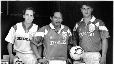 Sydney Croatia became Sydney United in 1993. Mario Jerman, Manis Lamond and Ivan Topic model the jerseys brought in at the time of the change.