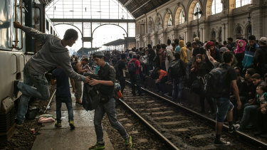 Migrants, mostly from Syria and Afghanistan, at Keleti station in Budapest in September 2015. German Chancellor Angela Merkel's decision to open Germany's doors to these asylum seekers triggered the current debate over immigration between Munich and Berlin.