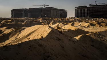 Construction workers in the first phase of Cairo's new capital: over the last two decades China unleashed a global lending spree in an effort to expand its influence and become a political and economic superpower.