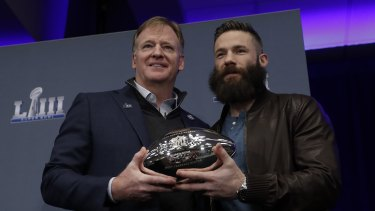 Roger Goodel poses with Edelman and the MVP trophy.