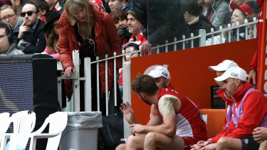 Alex Johnson's mother checks on him after he came off the ground with his injury.