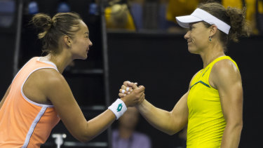 Shocking result: Lesley Kerkhove and Sam Stosur shake hands after their match.