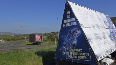 "A sign in a parking lot of a cemetery reads: ""No EU border in Ireland"" near Carrickcarnan, Ireland."