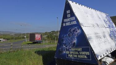 "A sign in a parking lot of a cemetery reads: ""No EU border in Ireland"" near Carrickcarnan, Ireland."