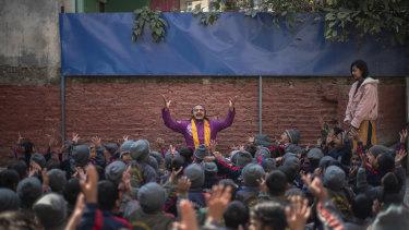Brishadev Gorakshadas, a teacher, leads a yoga class at Mount Genius English School in Kathmandu.