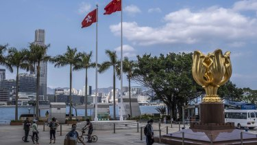 Golden Bauhinia Square, in Wan Chai area of Hong Kong. Setting a confrontational tone ahead of meetings in Alaska, the United States punished Chinese officials involved in eroding democracy in Hong Kong.