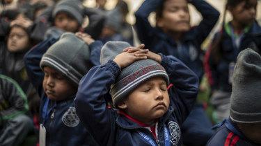 Children take part in a yoga class at Mount Genius English School, in Kathmandu.