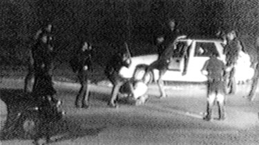 Police officers beat Rodney King on a Los Angeles freeway.
