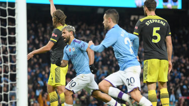 Sergio Aguero celebrates after scoring Manchester City's opening goal.