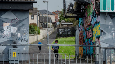 Graffiti from paramilitary groups in the Creggan area of Derry, Northern Ireland, in September.