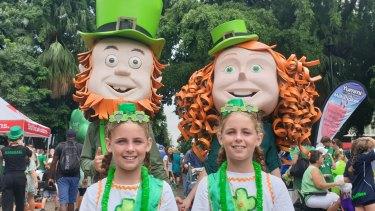 Brisbane twins Zamyra and Cherakeh Schmidt, 10, at the Brisbane Irish Festival after enjoying the parade.