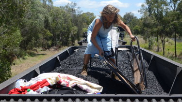 The zoology student climbed on top of a coal train and was confronted by police near the Port of Brisbane.