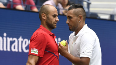 Into the next round: Kyrgios talks with doubles partner Marius Copil.