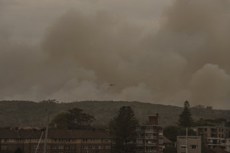 A hazard reduction that jumped containment lines has spread thick smoke across the city.
