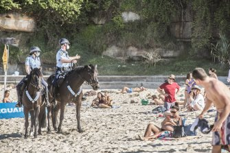 New South Wales police patrol Bondi Beach on Saturday as part of keeping COVID-19 restrictions in place.