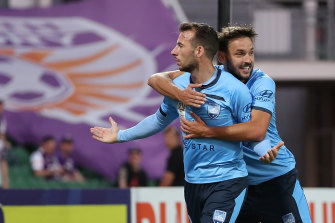 Milos Ninkovic celebrates with Adam Le Fondre, who scored the penalty that the Serbian midfielder drew against Perth Glory.