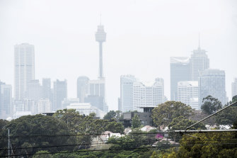 Sydney battled smog for another day as thunderstorms were predicted for Saturday.