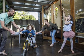 Caroline Willis and Lionel Bonnafous and their children, Emmanuelle, with home-made bow and arrow, and Theodore, who is learning to ride his new bike.