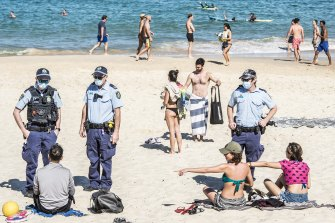 Police patrolling Bondi Beach to enforce compliance with the COVID-19 lockdown restrictions.