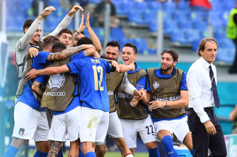 The Italians celebrate Matteo Pessina's goal against Wales.